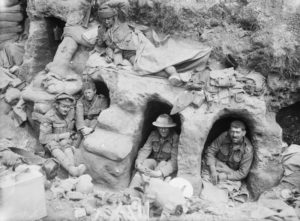 Border Regiment men in dugouts - Battle of the Somme August 1916 = commons.wikimedia.org