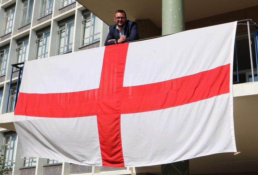 Cllr Marshall with the flag