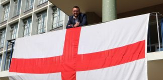 Cllr Marshall with the flag